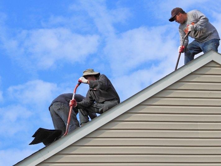 Men removing old roof