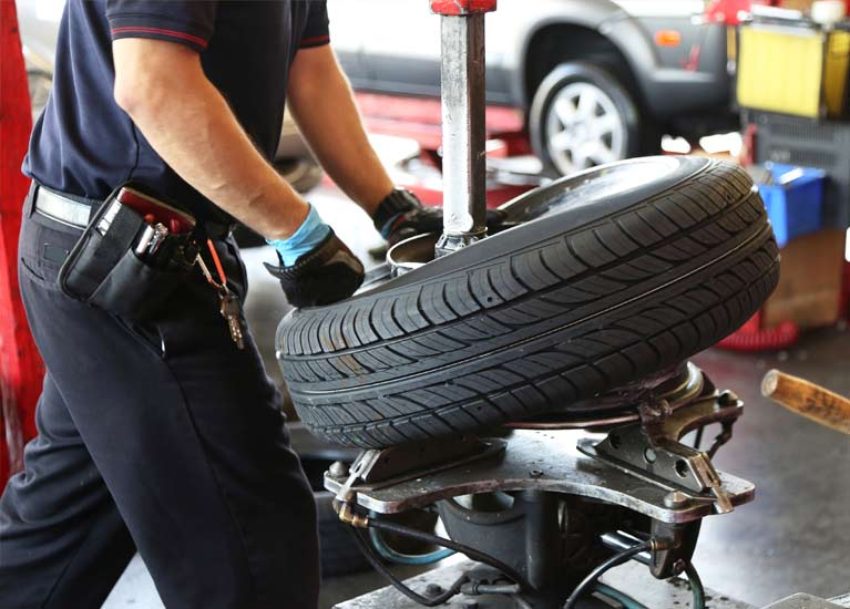 mechanic-changing-car-tyre