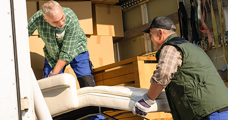Movers keeping furniture and boxes in the truck