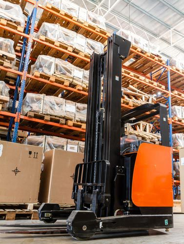 View of forklift and large lumber of commercial hardware