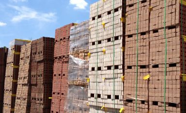 Pallets of bricks stacked up