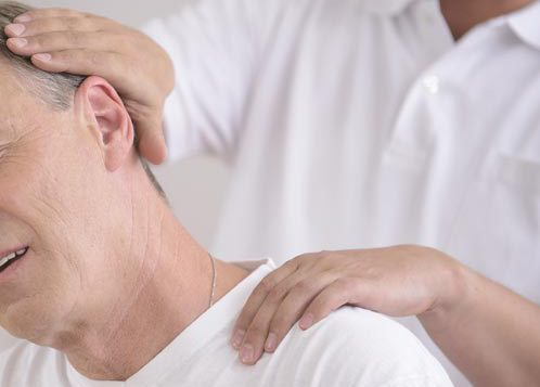 Chiropractor treating patient for chronic pain in Galesburg, IL