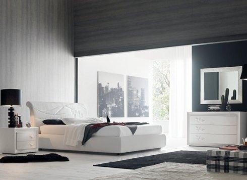 camera da letto con comò e specchiera
