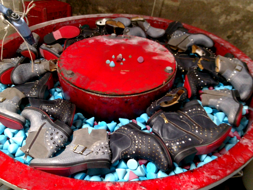 stone washing of leather footwear