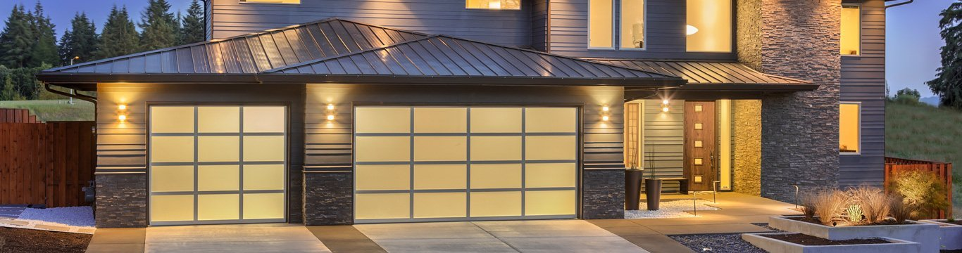 advance garage door systems home exterior at night