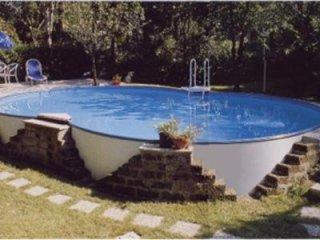 Raised waterfront swimming pool
