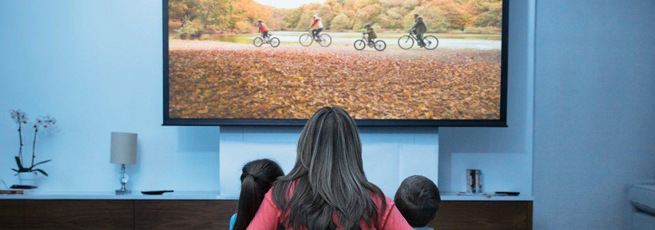 mom and children watching TV