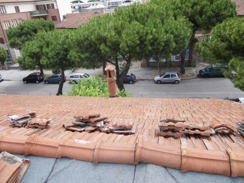 Asportazione e riposizionamento di coppi e tegole