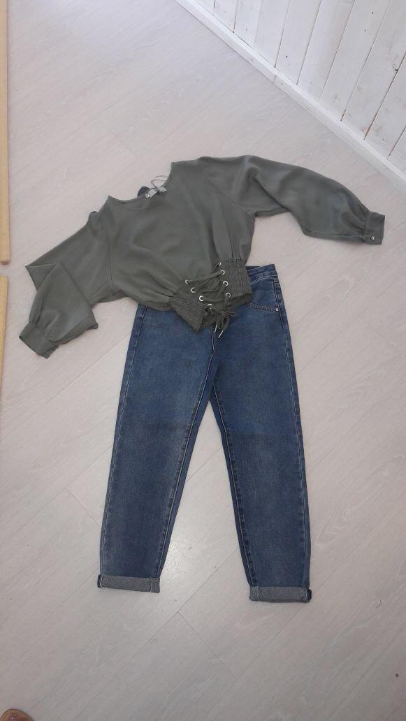 camicia e jeans da donna