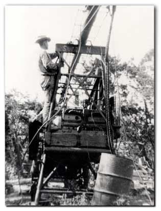Mr. Glass working on old time water well