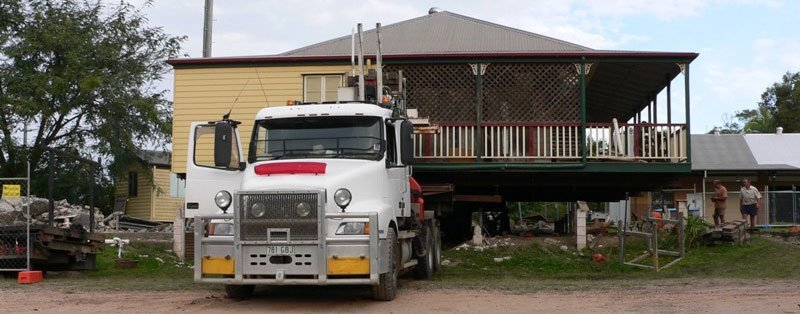 Yellow House On Removal Truck