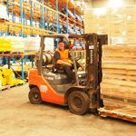 employee doing warehouse freight transportation services