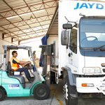 operator using forklift to place products on truck
