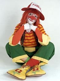 sitting smiling clown