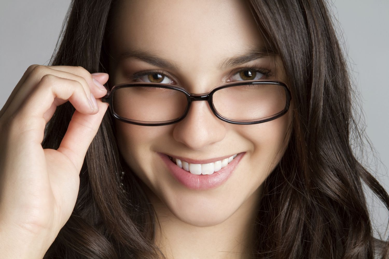 woman trying on glasses and contact lenses in Honolulu, HI