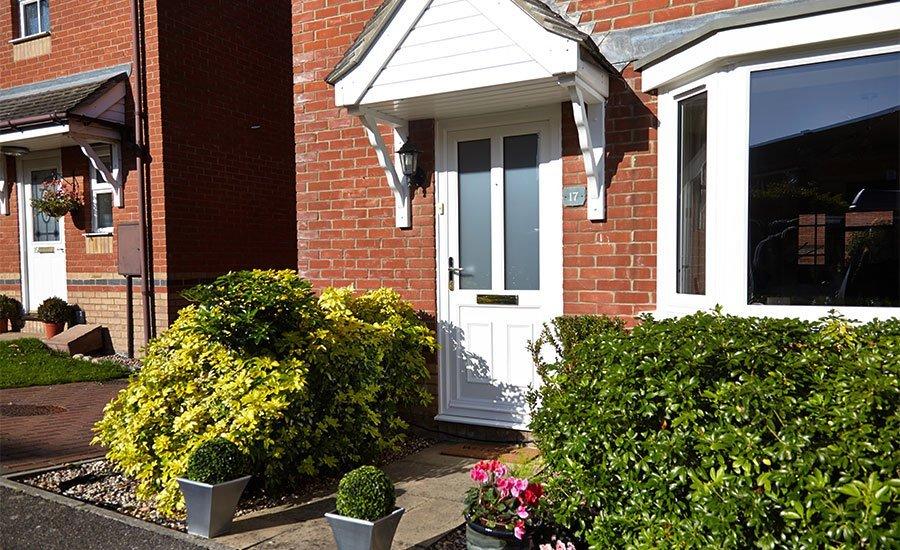 White front door with overhang