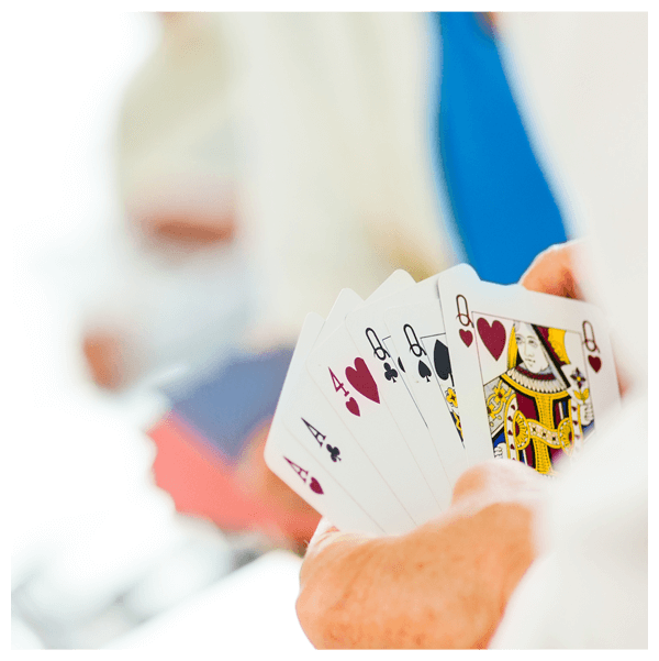 Man holding hand of cards
