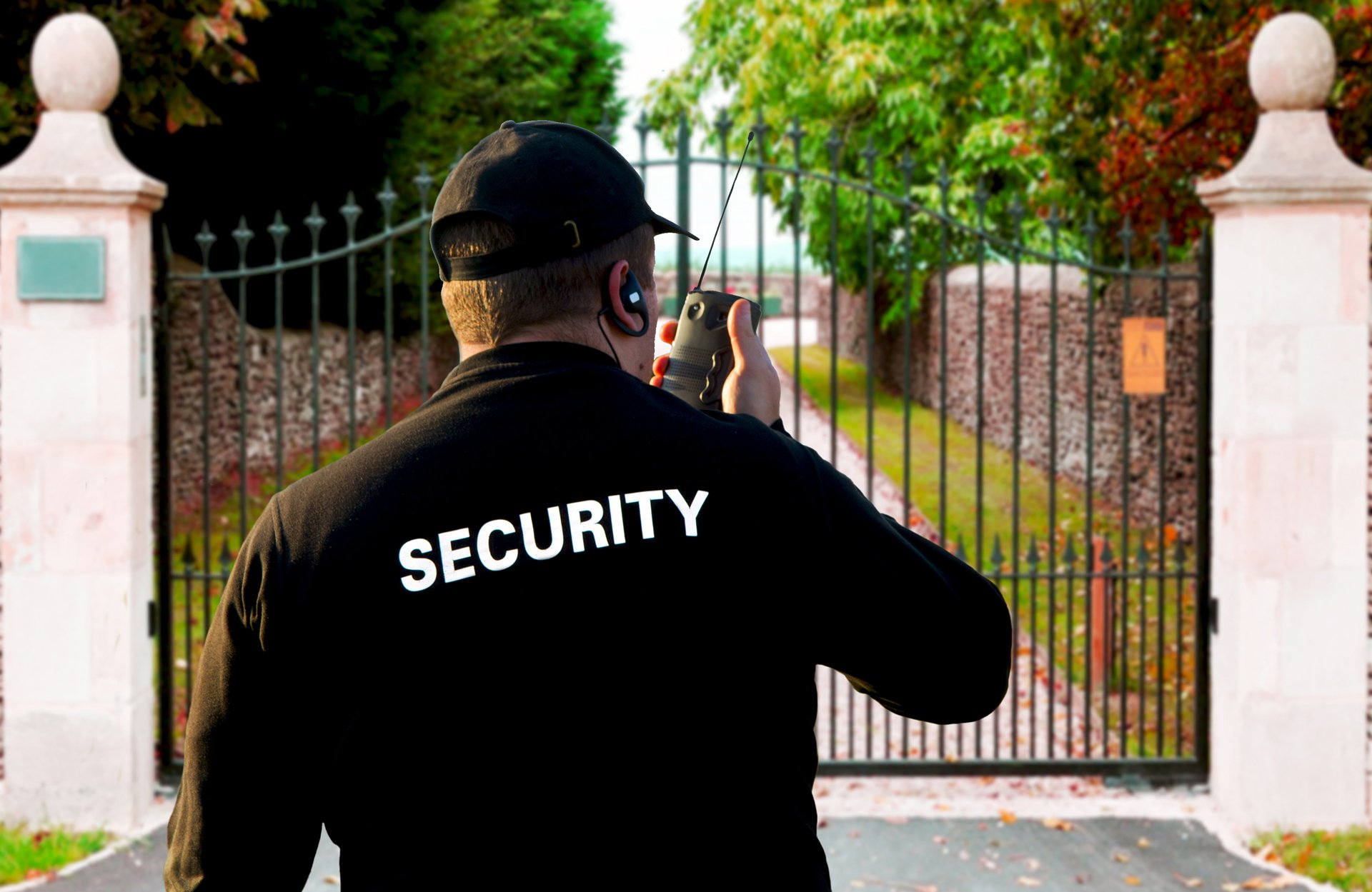Security guard in front of house iron gate
