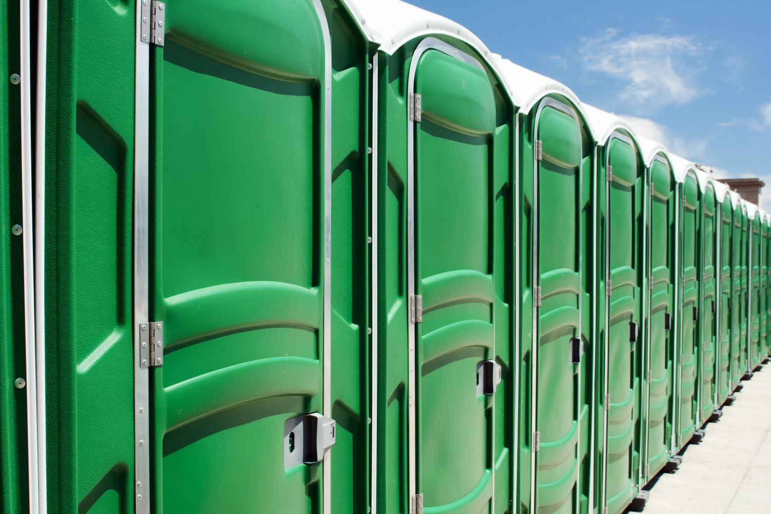 row of green portable toilets in Baxter, AR