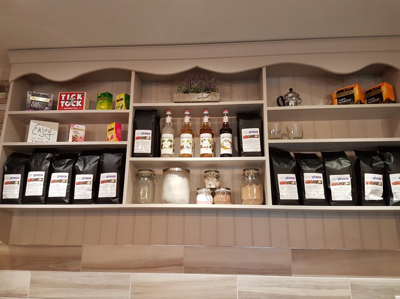 Shelf with different products at cafe alba