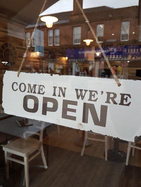 Open board outside cafe alba
