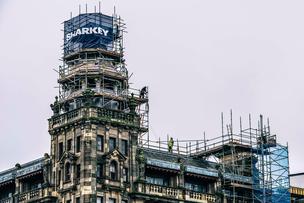 Scaffolding around top of old building