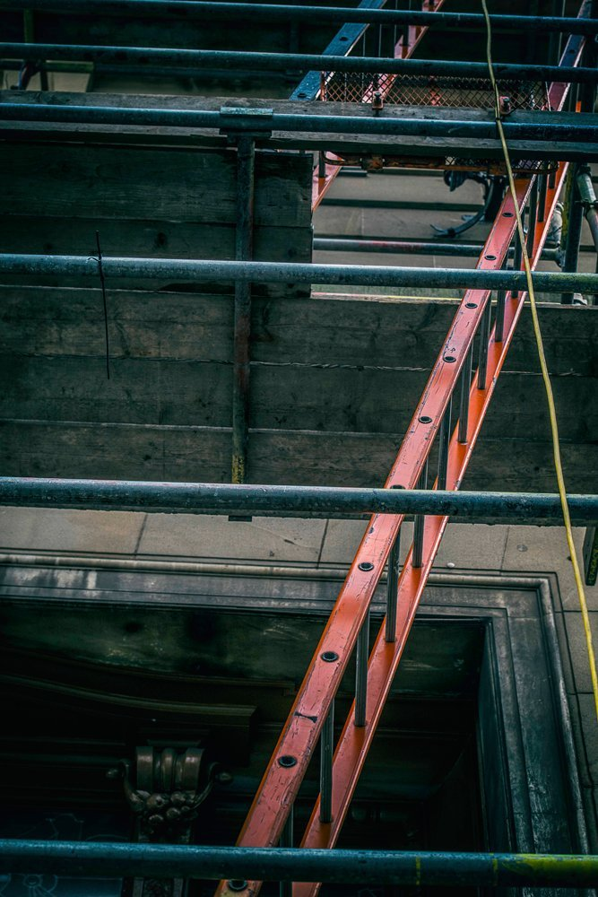 Ladder access to scaffolding tower
