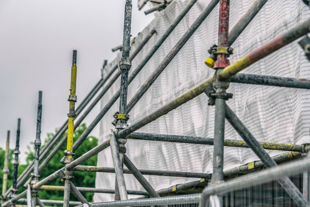 Close up of scaffolding with protective safety net