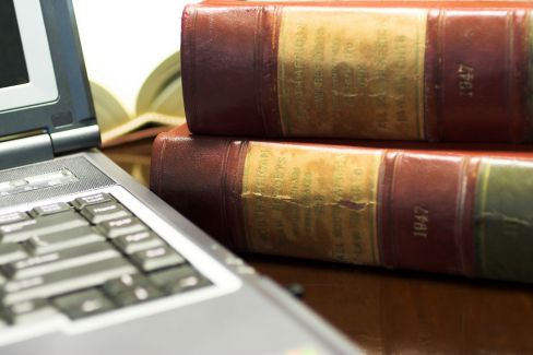 Laptop and law books for an attorney in Pell City, AL