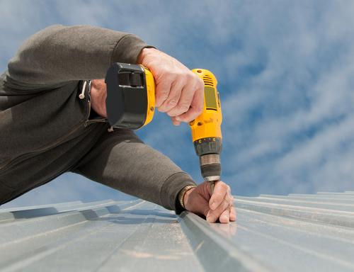 Man repairing roof exteriors
