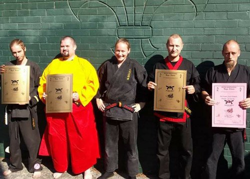 ninja trainers holding certificates