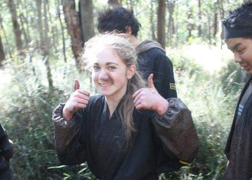 ninja training girl with thumbs up