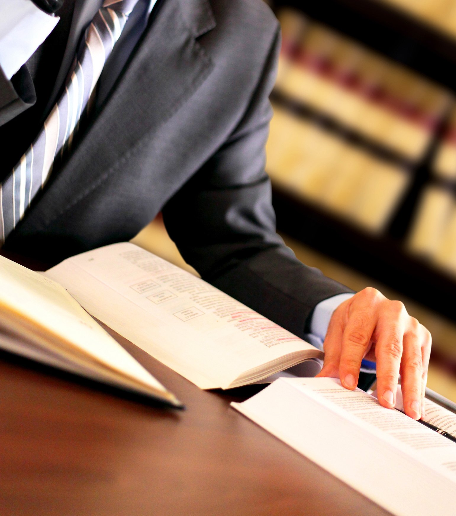 Lawyer reading through law books