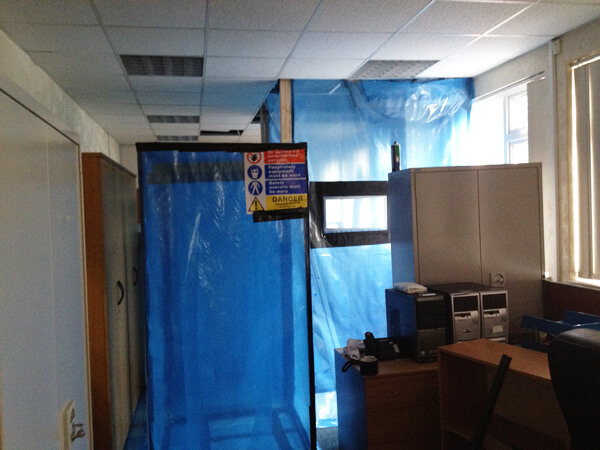 Inside an office with plastic sheeting up
