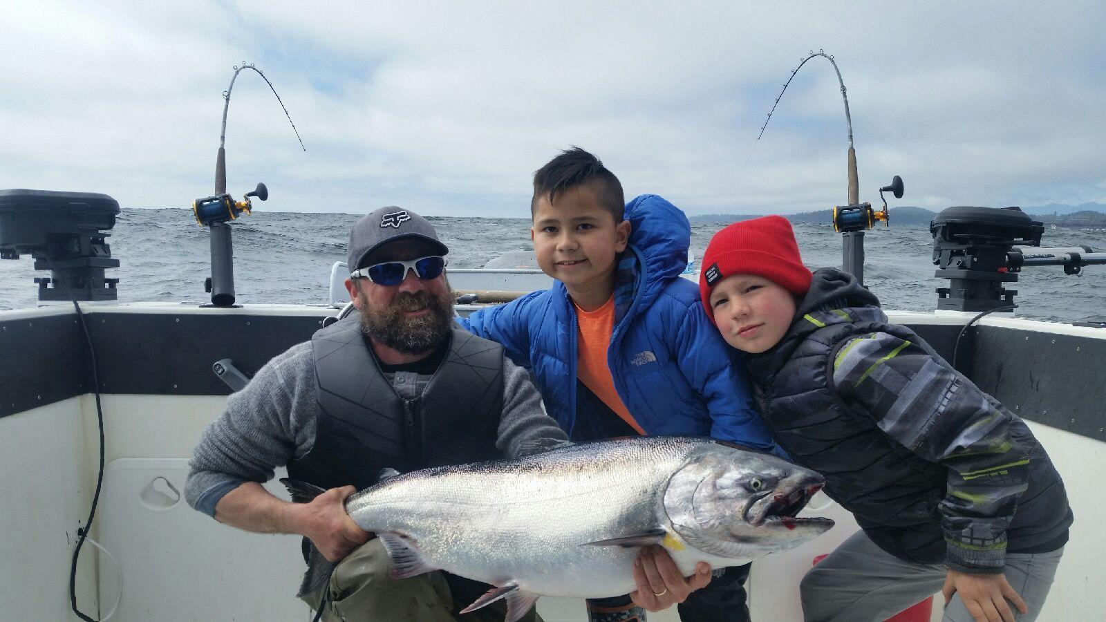 Man Holds Big Salmon