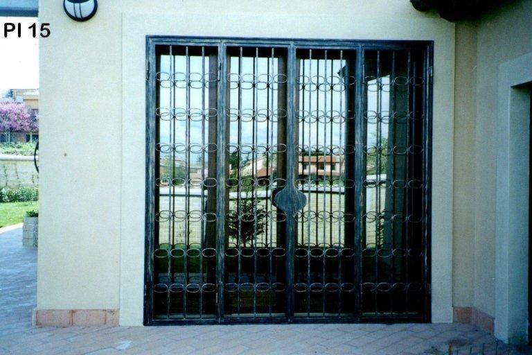 portone d'ingresso ferro battuto
