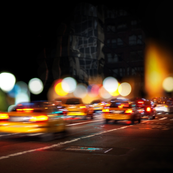 Taxis driving at night