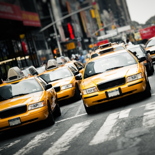 Taxi cabs on crowded road