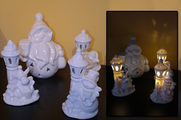 Statue in ceramica bianca con candela