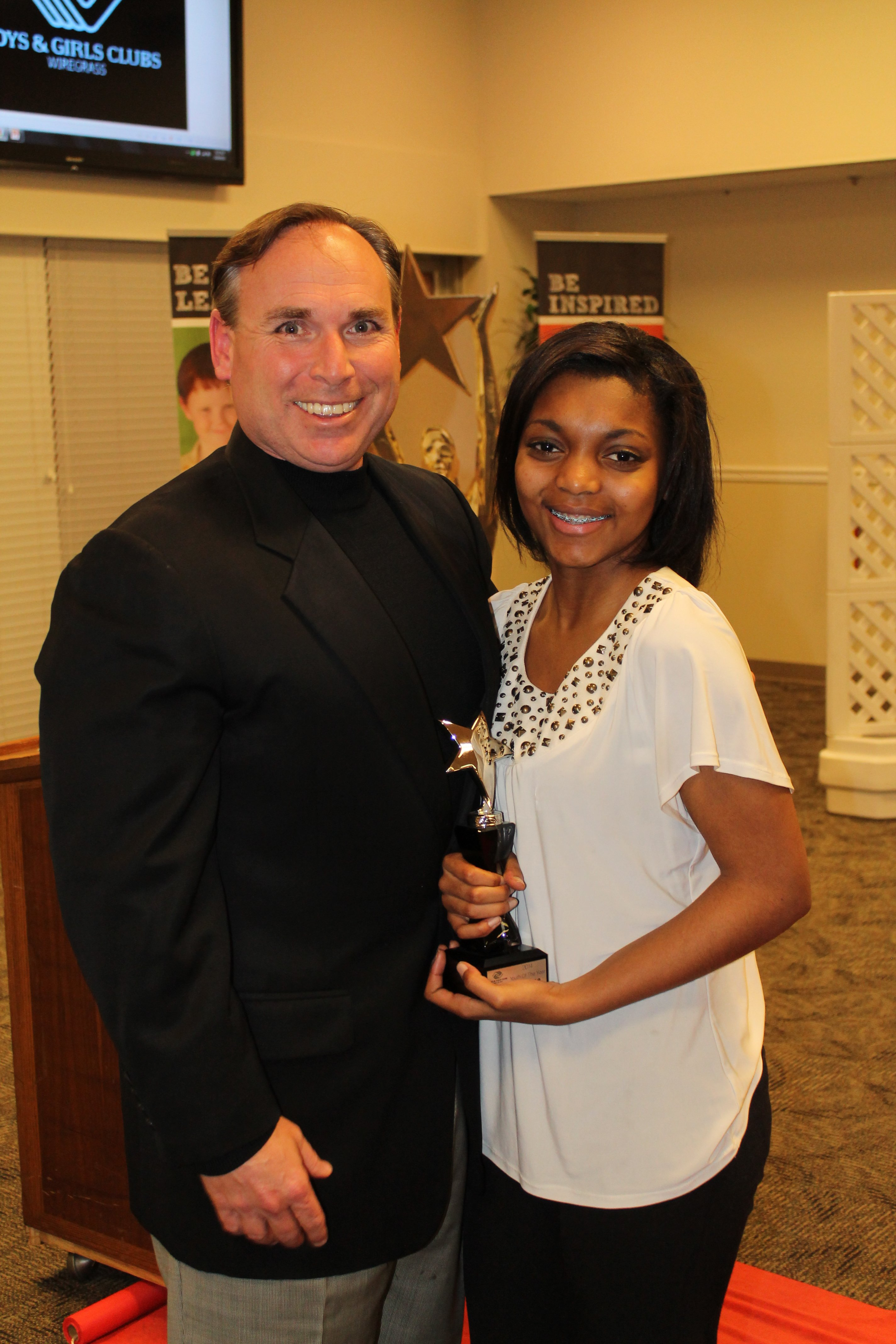2014 Youth of the Year Jacara Moore with BGCW Board President, Scott Applefield
