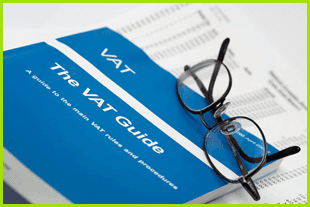 A VAT Returns guide and picture of a pair of glasses