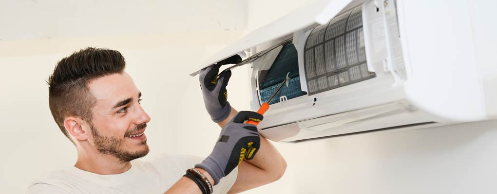 Air conditioner being repaired by professional
