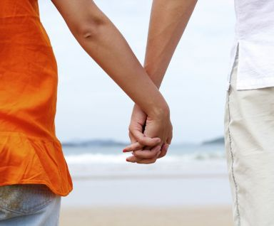 Couple holding hands after visiting our family therapist in Honolulu, HI