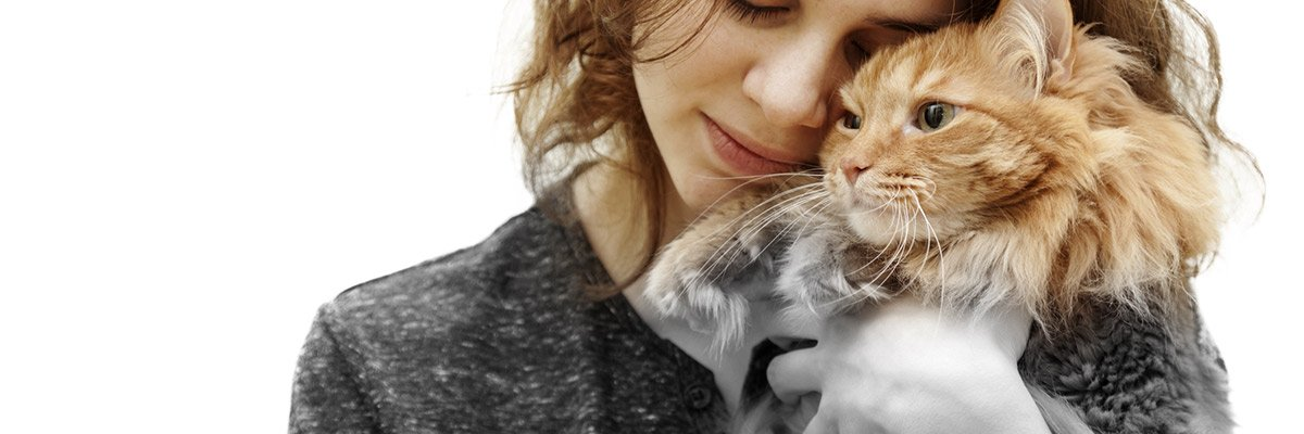woman hugging her cat