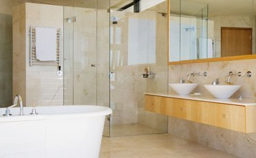 A stylish bathroom with a glass shower