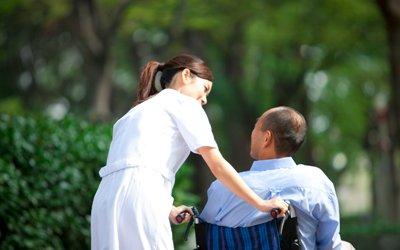 premier care pty ltd patient on wheelchair with nurse