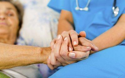 premier care pty ltd nurse holding hands of patient