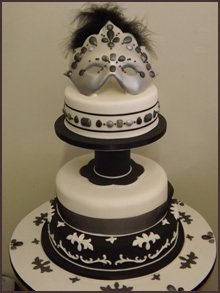 Theatre mask on a two-tier cake