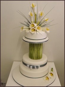 Orchids on top of a two tier cake