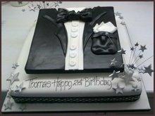 Black and white tuxedo shaped cake